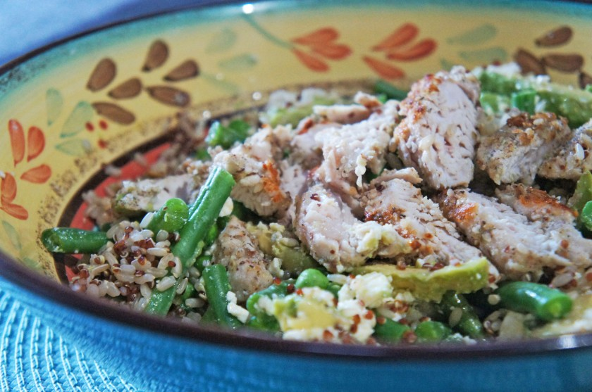 A quinoa salad with spring greens, chicken and seeds