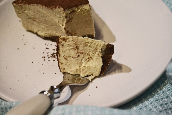 A creamy no bake cheesecake with a coffee flavour and walnut base